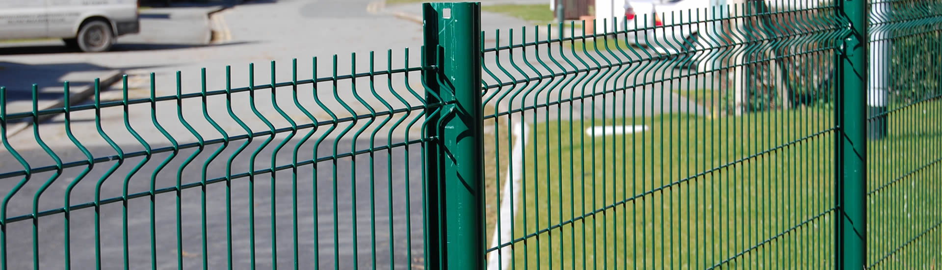 Green PVC coated single welded wire fences are installed on the street.