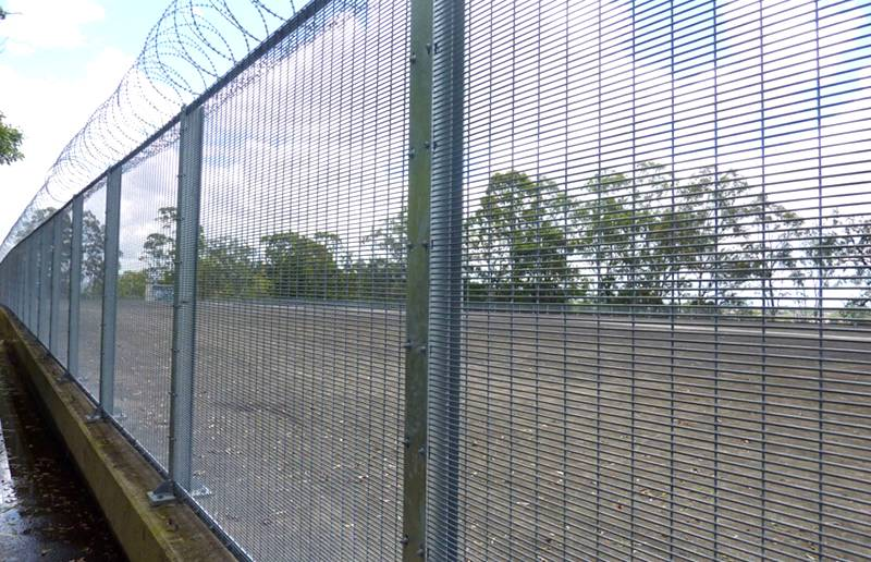 338 security fence with co<em></em>ncertina razor wire on the top.