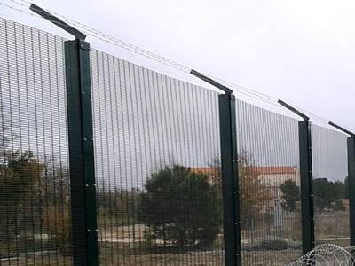 3510 security perimeter mesh with top barb wire.