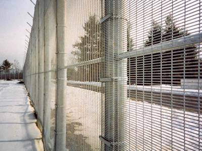 358 prison mesh with finger-proof spacing hard to climb over.