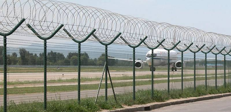 Airport perimeter security fence is combined by welded wire fence with top concertina wire.