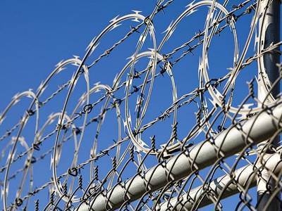 Flat Wrap Razor Wire - a Safer Barrier for Perimeter Fencing