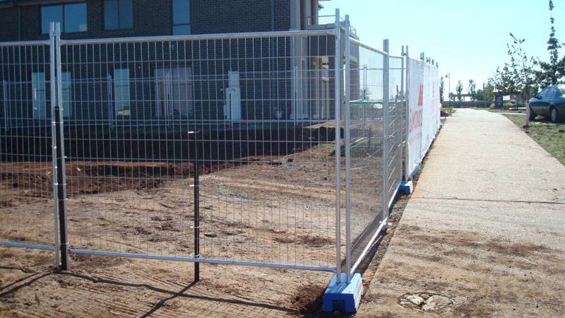Welded wire temporary panels as construction site barrier.