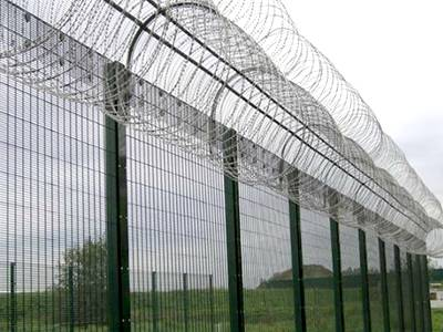 358 security fence with concertina razor wire topping fear away intruders.