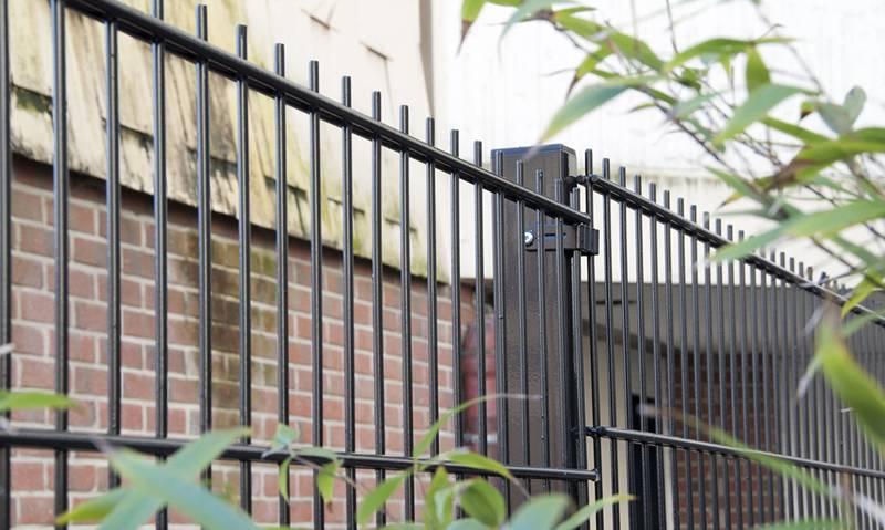 Twin horizo<em></em>ntal high security fence with black vinyl-coating.